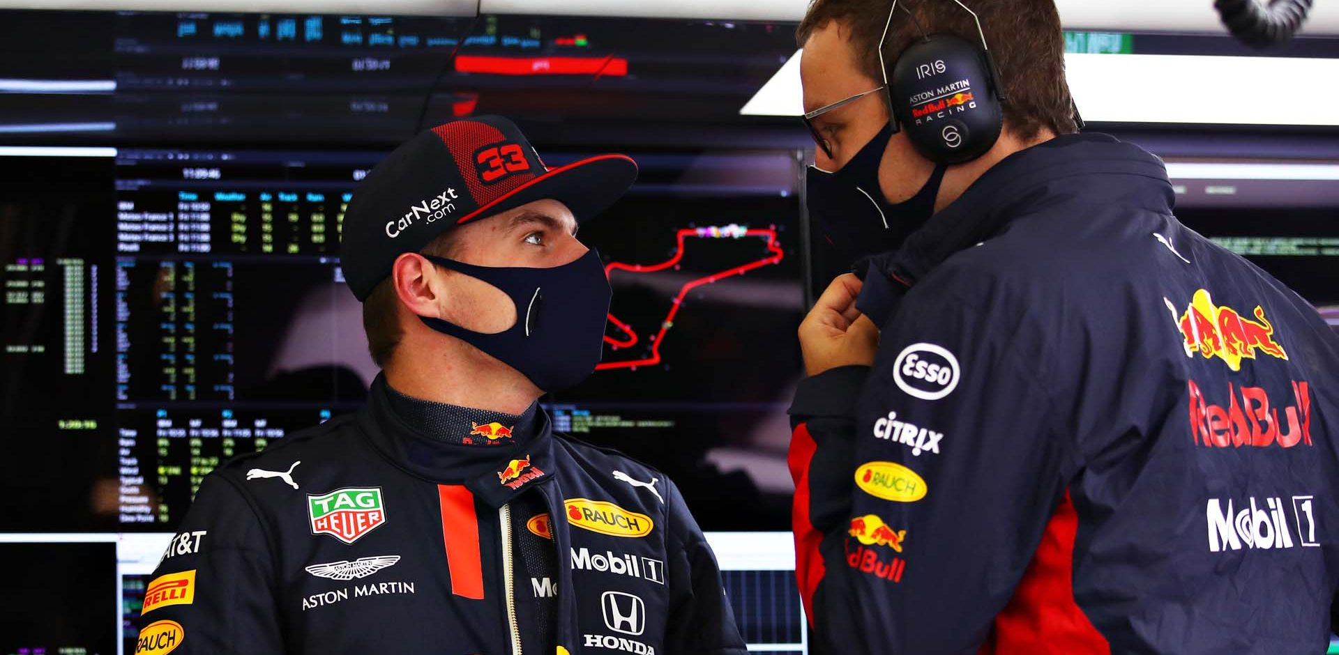 ISTANBUL, TURKEY - NOVEMBER 13: Max Verstappen of Netherlands and Red Bull Racing talks with a Red Bull Racing engineer in the garage during practice ahead of the F1 Grand Prix of Turkey at Intercity Istanbul Park on November 13, 2020 in Istanbul, Turkey. (Photo by Bryn Lennon/Getty Images)