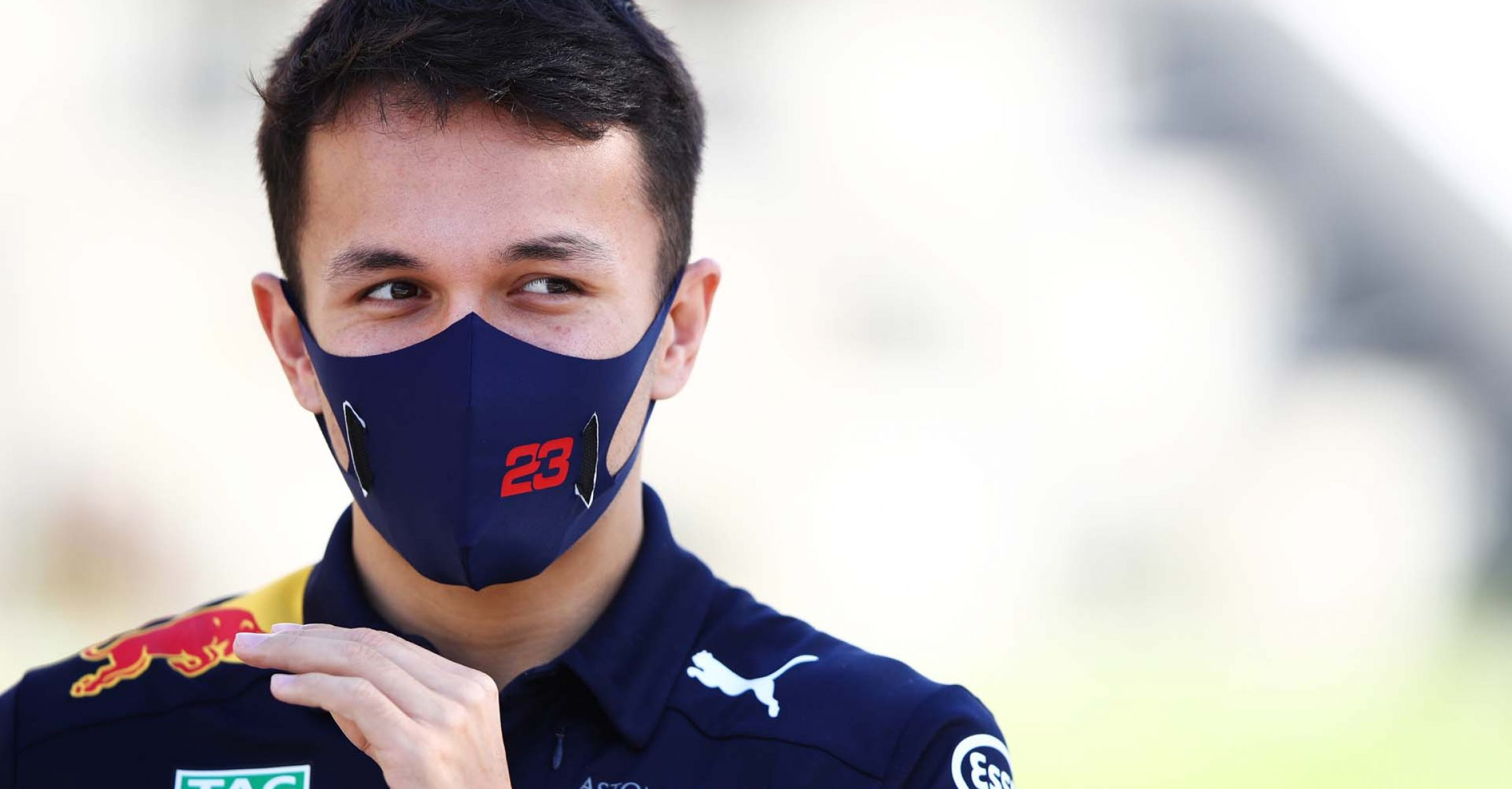 BAHRAIN, BAHRAIN - NOVEMBER 26: Alexander Albon of Thailand and Red Bull Racing looks on in the Paddock during previews ahead of the F1 Grand Prix of Bahrain at Bahrain International Circuit on November 26, 2020 in Bahrain, Bahrain. (Photo by Mark Thompson/Getty Images)