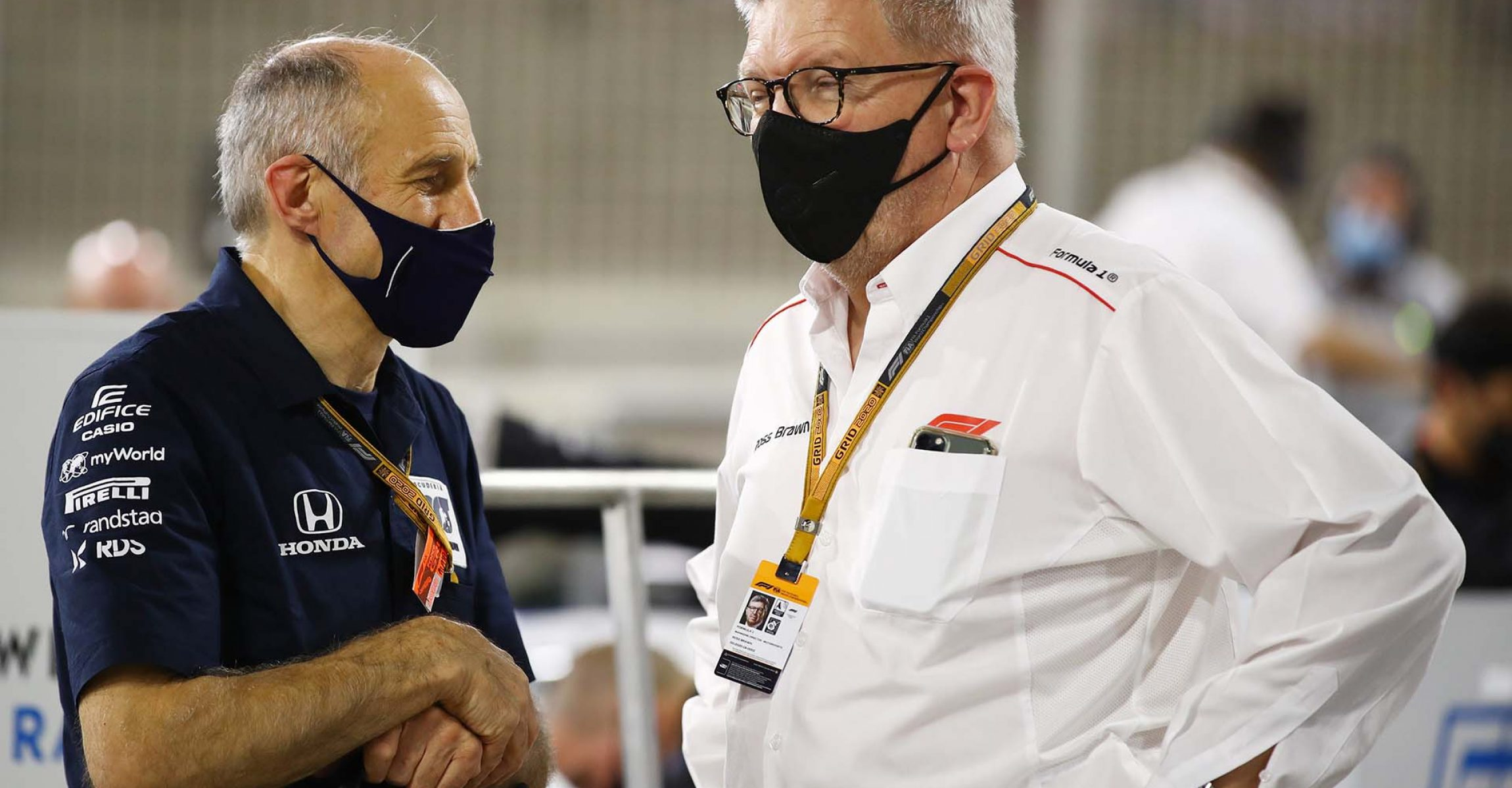BAHRAIN, BAHRAIN - NOVEMBER 29: Scuderia AlphaTauri Team Principal Franz Tost and Ross Brawn, Managing Director (Sporting) of the Formula One Group, talk during the F1 Grand Prix of Bahrain at Bahrain International Circuit on November 29, 2020 in Bahrain, Bahrain. (Photo by Mark Thompson/Getty Images)