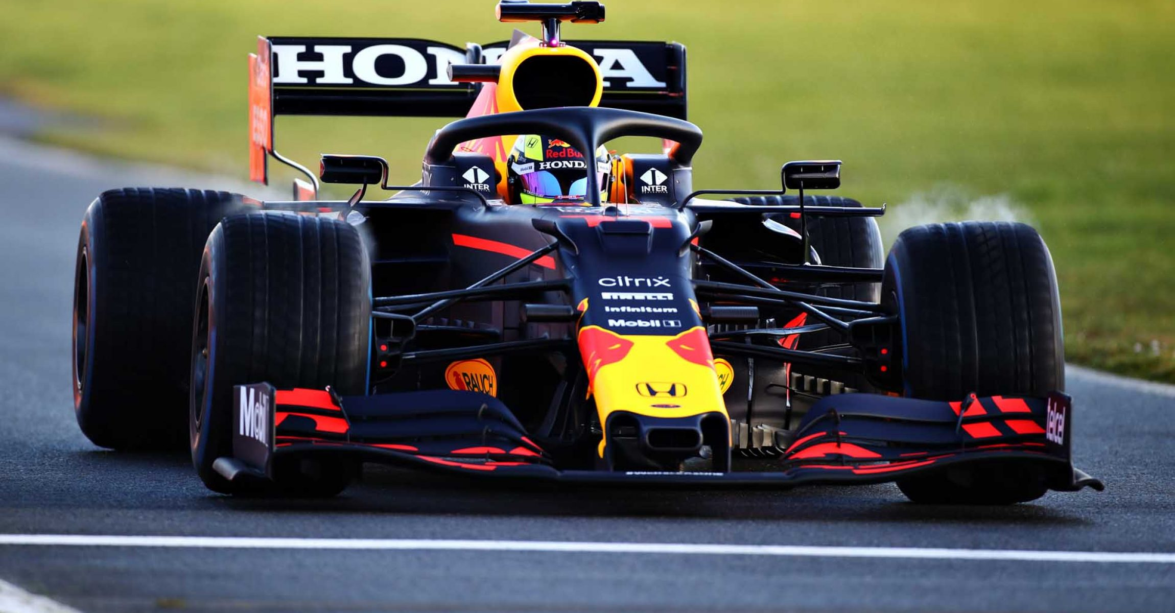 NORTHAMPTON, ENGLAND - FEBRUARY 22: Sergio Perez of Mexico driving the (11) Red Bull Racing RB15 Honda at Silverstone on February 22, 2021 in Northampton, England. (Photo by Bryn Lennon/Getty Images for Red Bull Racing)