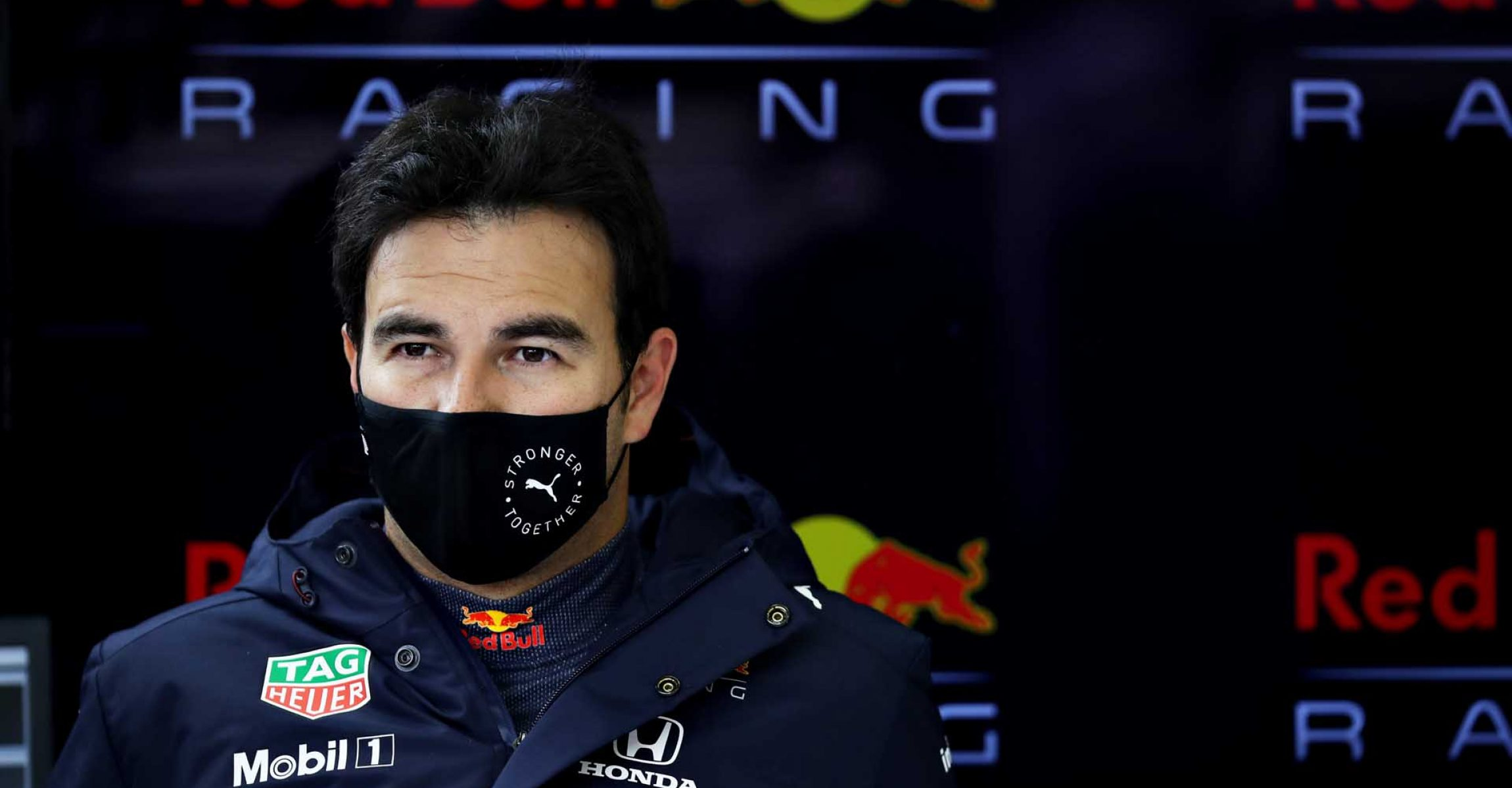 NORTHAMPTON, ENGLAND - FEBRUARY 23: Sergio Perez of Mexico and Red Bull Racing prepares to drive in the garage during the Red Bull Racing filming day at Silverstone on February 23, 2021 in Northampton, England. (Photo by Mark Thompson/Getty Images for Red Bull Racing)