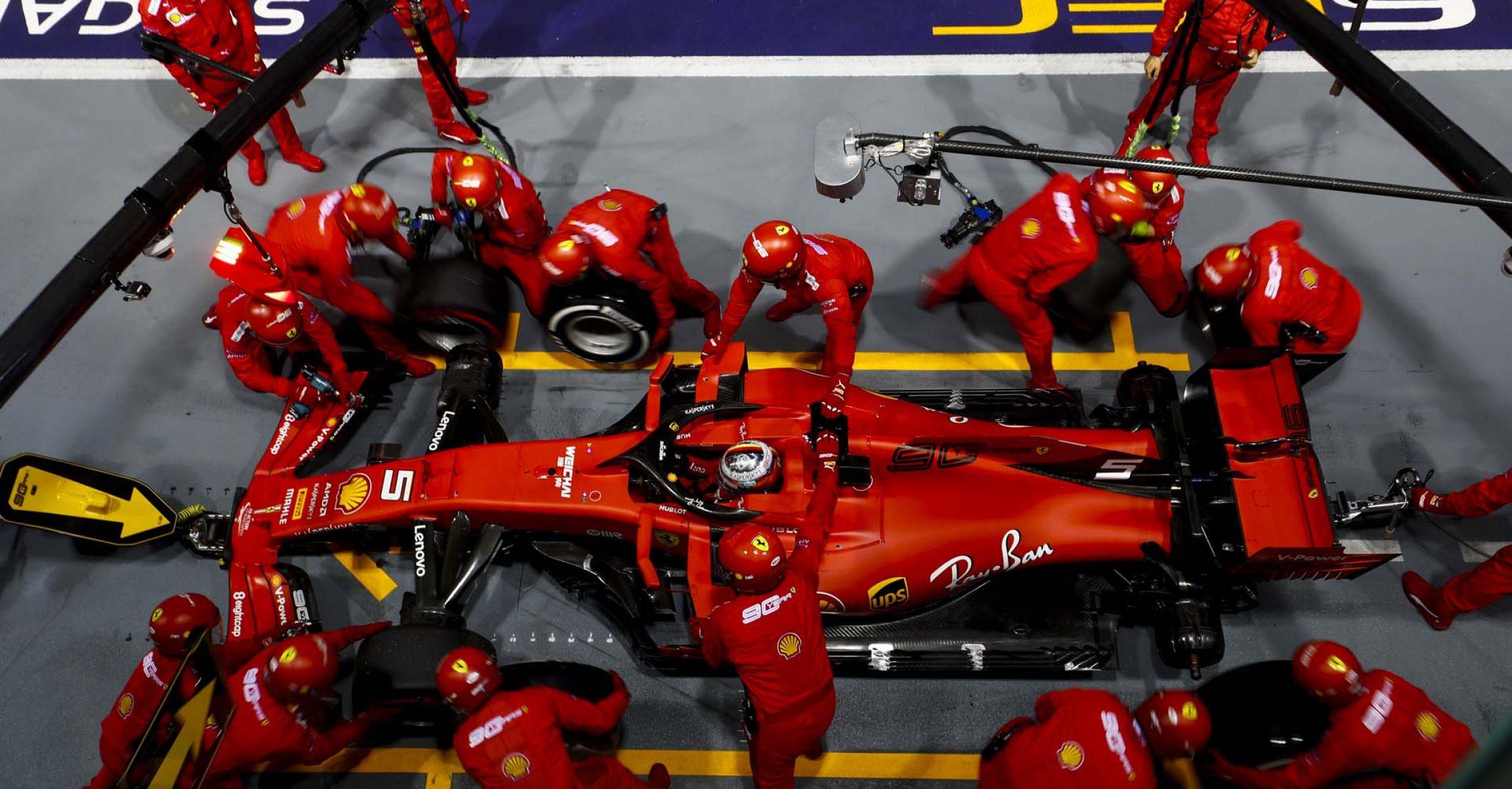 SINGAPORE STREET CIRCUIT, SINGAPORE - SEPTEMBER 22: Sebastian Vettel, Ferrari SF90 pit stop during the Singapore GP at Singapore Street Circuit on September 22, 2019 in Singapore Street Circuit, Singapore. (Photo by Sam Bloxham / LAT Images)
