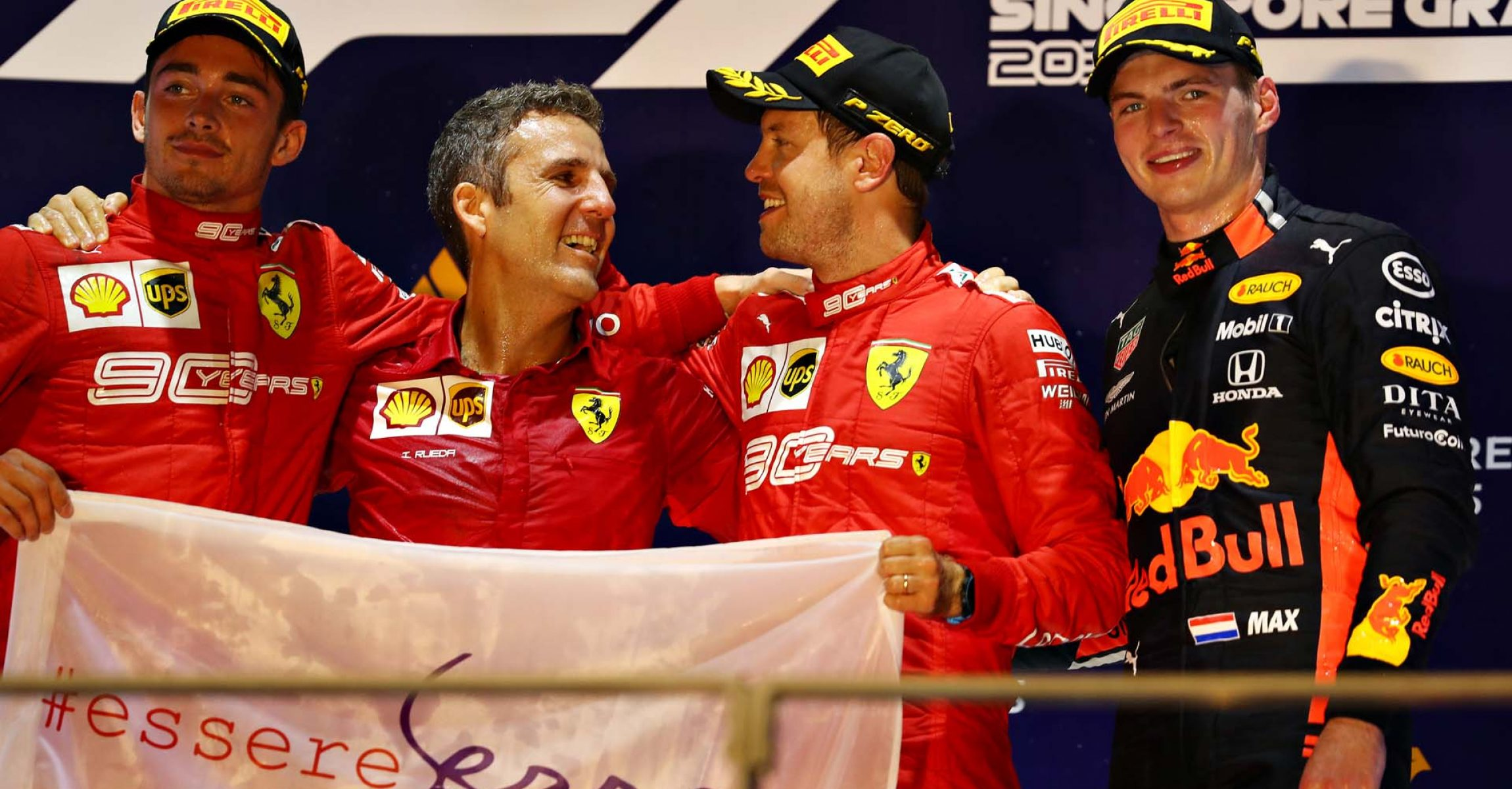 SINGAPORE, SINGAPORE - SEPTEMBER 22: Top three finishers Sebastian Vettel of Germany and Ferrari, Charles Leclerc of Monaco and Ferrari and Max Verstappen of Netherlands and Red Bull Racing celebrate on the podium during the F1 Grand Prix of Singapore at Marina Bay Street Circuit on September 22, 2019 in Singapore. (Photo by Mark Thompson/Getty Images) // Getty Images / Red Bull Content Pool  // AP-21NB3SZZ91W11 // Usage for editorial use only //