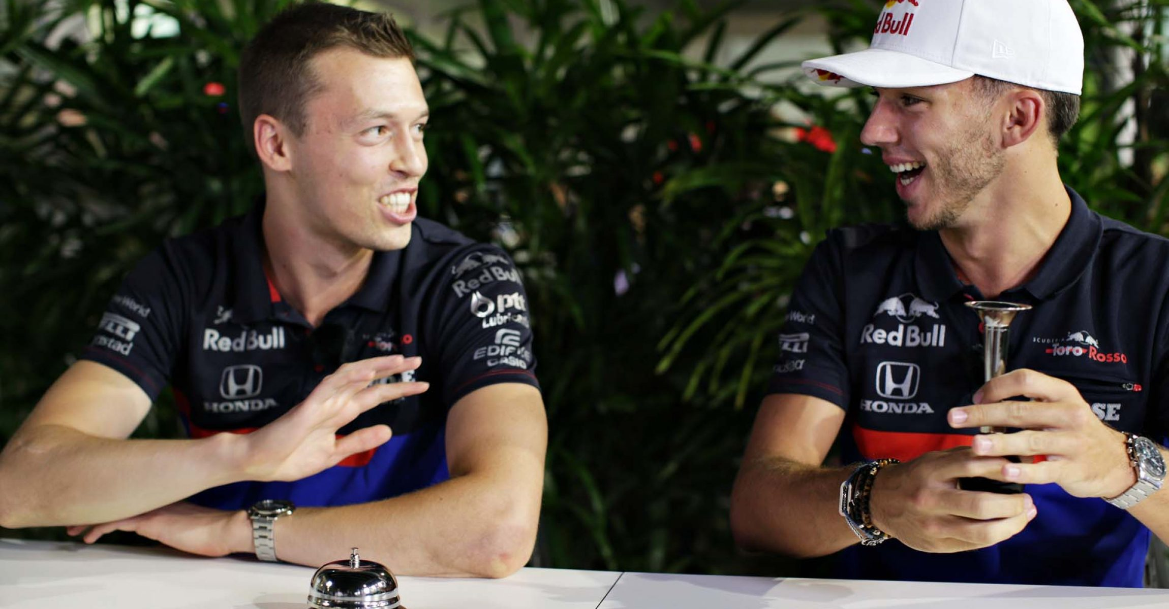 SINGAPORE, SINGAPORE - SEPTEMBER 19: Daniil Kvyat of Russia and Scuderia Toro Rosso and Pierre Gasly of France and Scuderia Toro Rosso laugh in the Paddock during previews ahead of the F1 Grand Prix of Singapore at Marina Bay Street Circuit on September 19, 2019 in Singapore. (Photo by Peter Fox/Getty Images) // Getty Images / Red Bull Content Pool // AP-21MATNA1N1W11 // Usage for editorial use only //