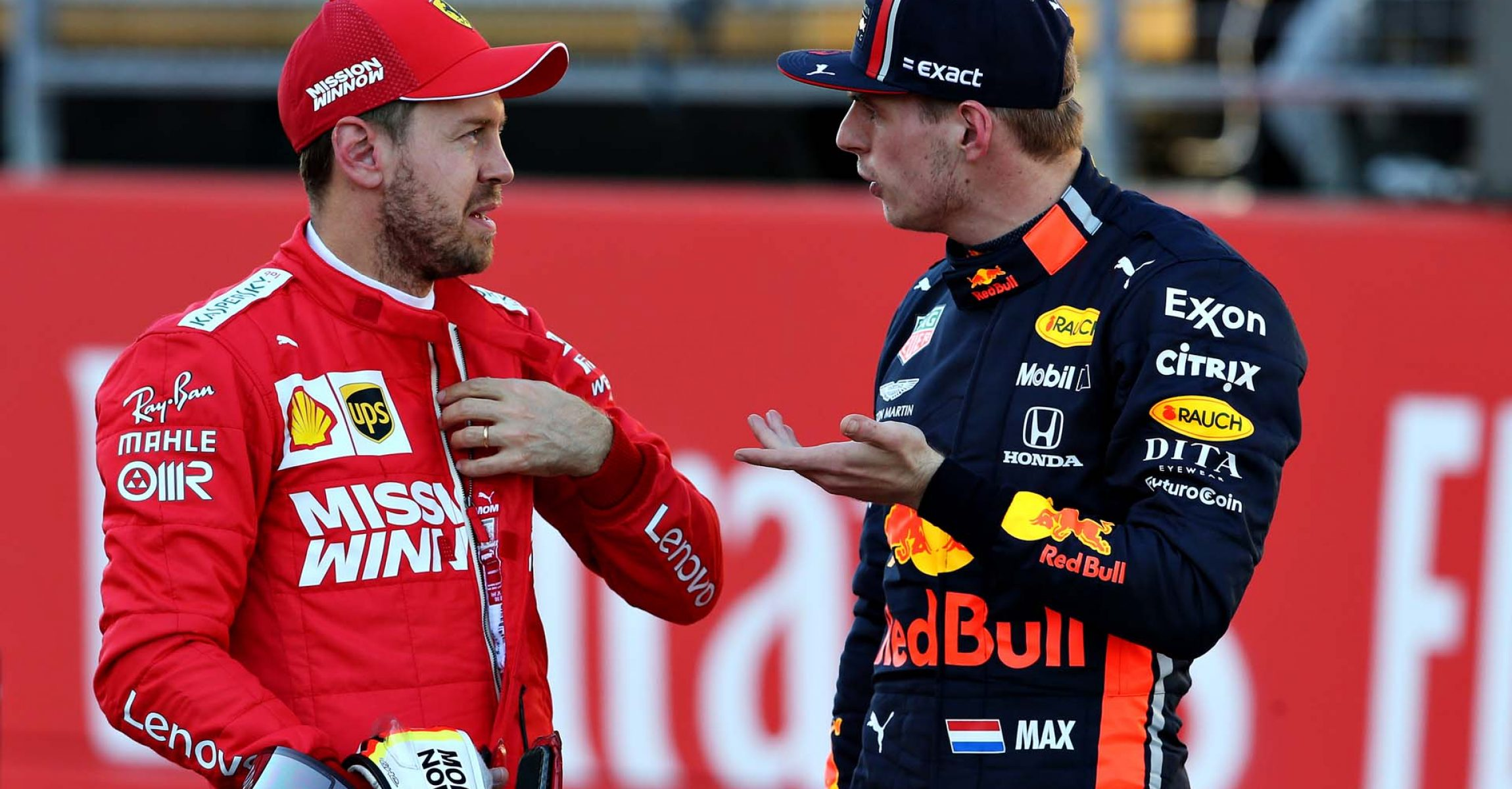 AUSTIN, TEXAS - NOVEMBER 02: Second place qualifier Sebastian Vettel of Germany and Ferrari talks with third place qualifier Max Verstappen of Netherlands and Red Bull Racing in parc ferme during qualifying for the F1 Grand Prix of USA at Circuit of The Americas on November 02, 2019 in Austin, Texas. (Photo by Charles Coates/Getty Images) // Getty Images / Red Bull Content Pool  // AP-222MHPBKS1W11 // Usage for editorial use only //