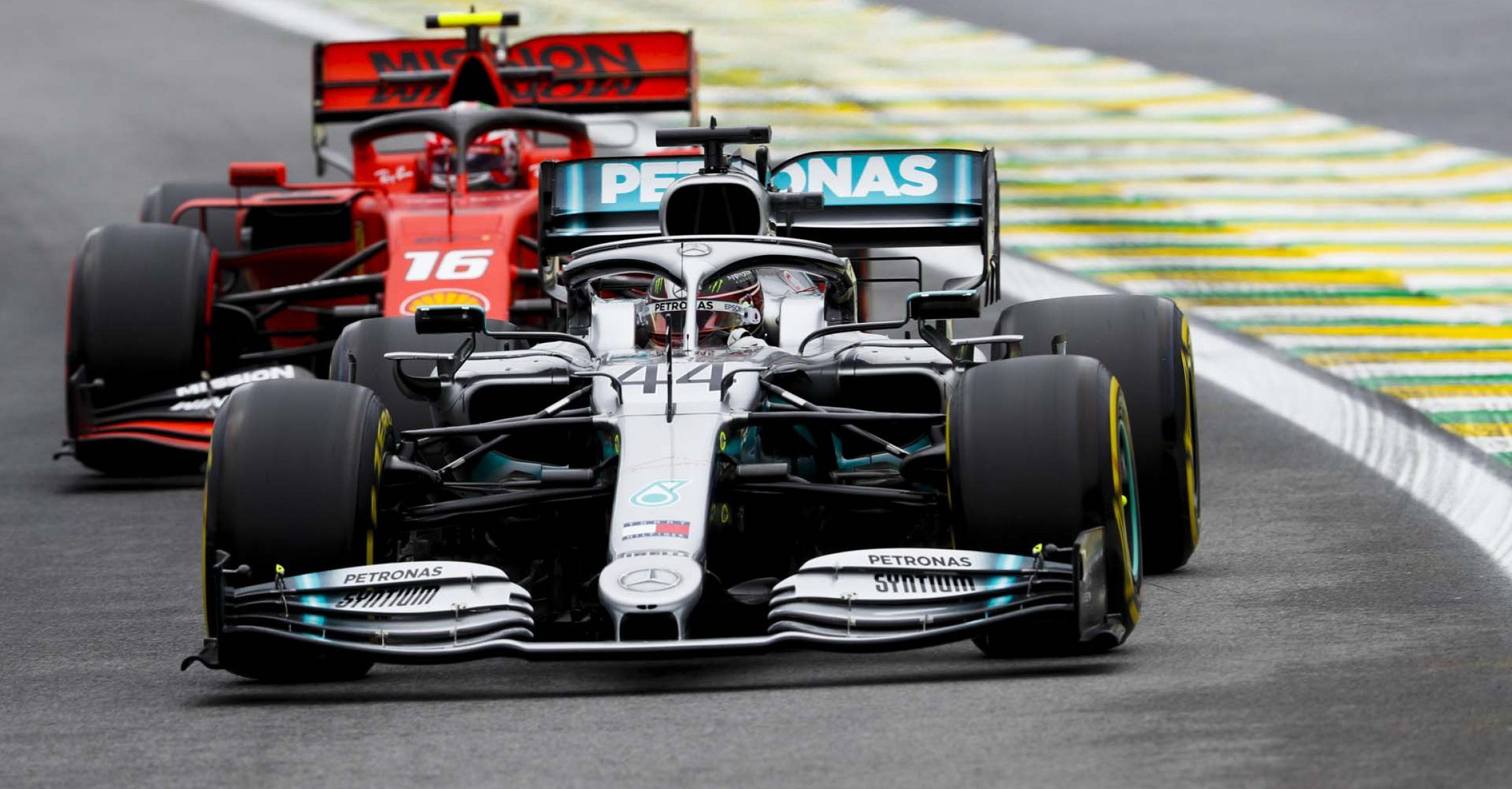 SAO PAULO, BRAZIL - NOVEMBER 15: Lewis Hamilton, Mercedes AMG F1 W10 and Charles Leclerc, Ferrari SF90 during the 2019 Formula One Brazilian Grand Prix at Autódromo José Carlos Pace, on November 15, 2019 in Sao Paulo, Brazil. (Photo by Zak Mauger / LAT Images)