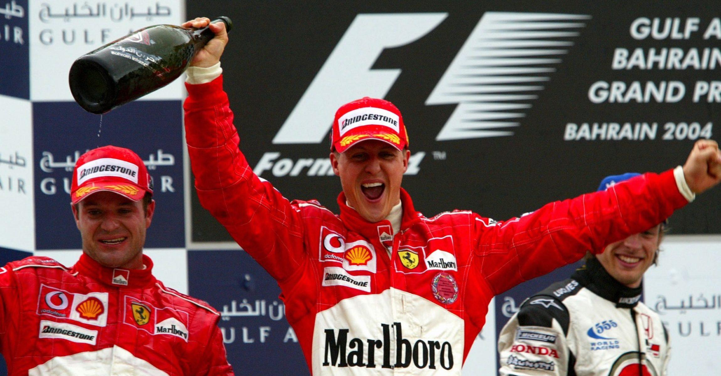 Race winner Michael Schumacher (GER) Ferrari on the podium. Formula One World Championship, Rd3, Bahrain Grand Prix, Race Day, Bahrain International Circuit, Bahrain, 4 April 2004. DIGITAL IMAGE BEST IMAGE