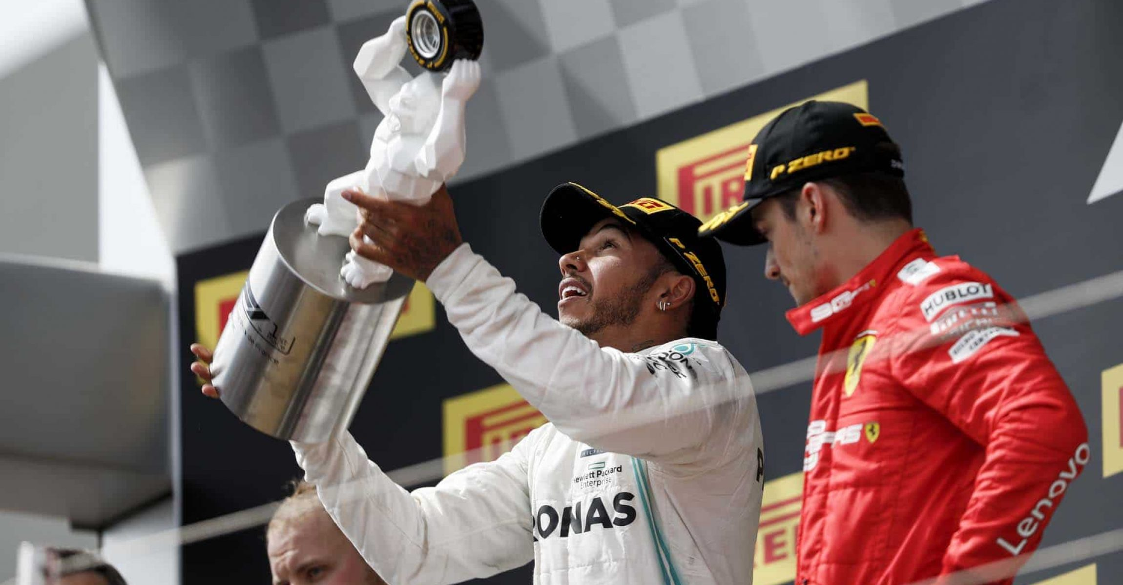 CIRCUIT PAUL RICARD, FRANCE - JUNE 23: Lewis Hamilton, Mercedes AMG F1, 1st position, celebrates with his trophy with Charles Leclerc, Ferrari, 3rd position, alongside during the French GP at Circuit Paul Ricard on June 23, 2019 in Circuit Paul Ricard, France. (Photo by Zak Mauger / LAT Images)