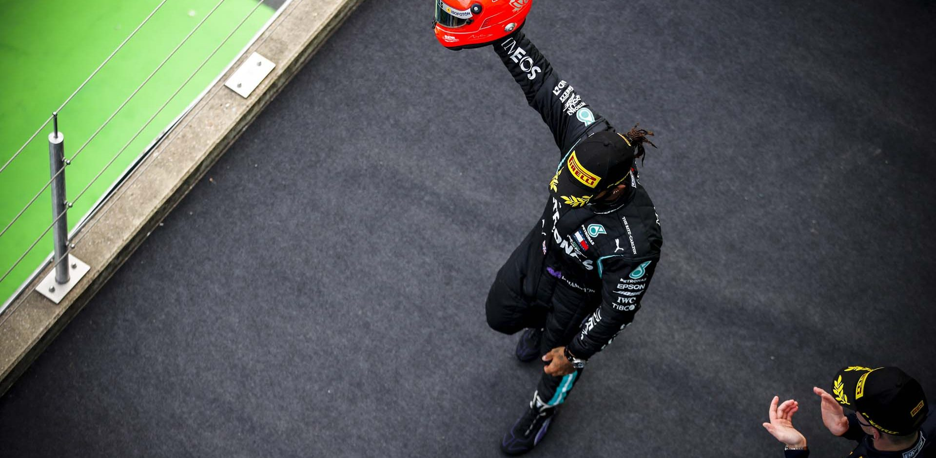 NüRBURGRING, GERMANY - OCTOBER 11: Lewis Hamilton, Mercedes-AMG Petronas F1, 1st position, arrives on the podium with the helmet of Michael Schumacher that was presented to him by Mick Schumacher during the Eifel GP at Nürburgring on Sunday October 11, 2020, Germany. (Photo by Zak Mauger / LAT Images)