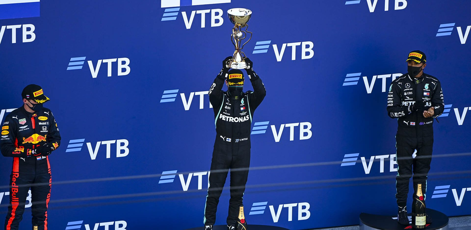 SOCHI AUTODROM, RUSSIAN FEDERATION - SEPTEMBER 27: Max Verstappen, Red Bull Racing, Race Winner Valtteri Bottas, Mercedes-AMG Petronas F1 and Lewis Hamilton, Mercedes-AMG Petronas F1 celebrate on the podium with the trophy during the Russian GP at Sochi Autodrom on Sunday September 27, 2020 in Sochi, Russian Federation. (Photo by Mark Sutton / LAT Images)